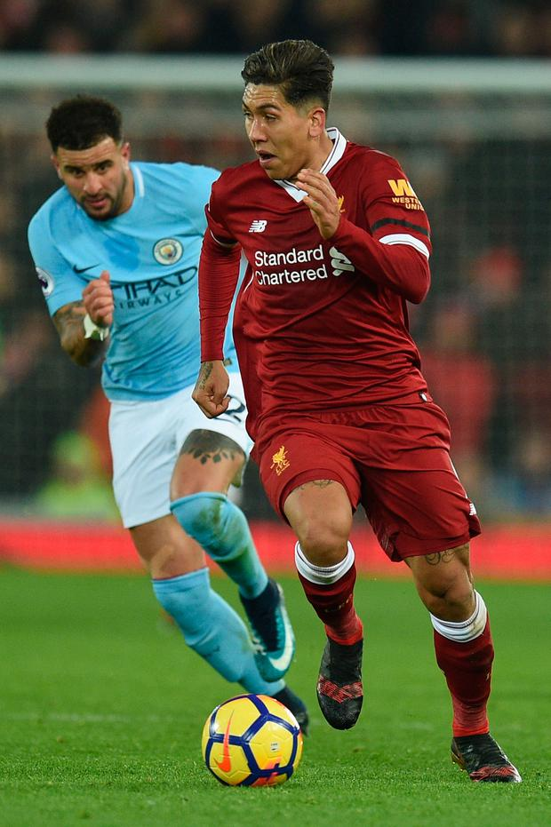 Liverpool's Roberto Firmino is chased by Manchester City's Kyle Walker. Photo: Getty Images