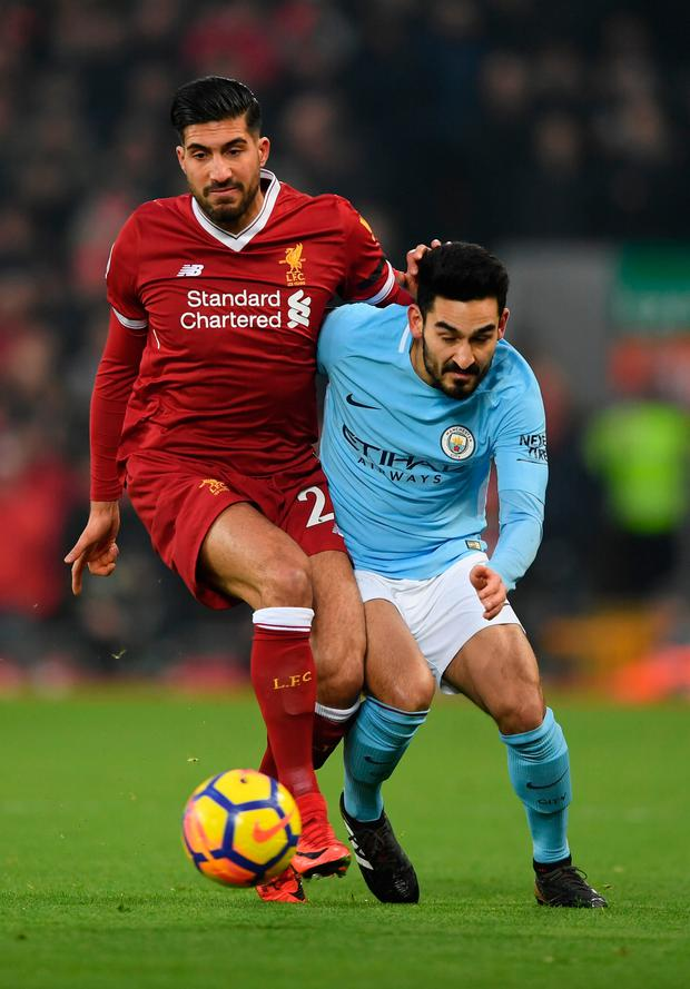 Liverpool's Emre Can challenges Manchester City's Ilkay Gundogan. Photo: Getty Images