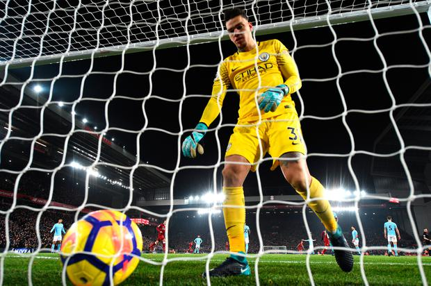 Manchester City's Ederson collects the ball from the back of the net after Sadio Mane's goal. Photo: Getty Images