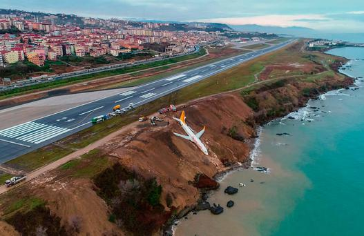 A Pegasus Airlines Boeing 737 passenger plane is seen stuck in mud on an embankment after skidding off the airstrip, having landed at an airport on the Black Sea coast Photo: Getty