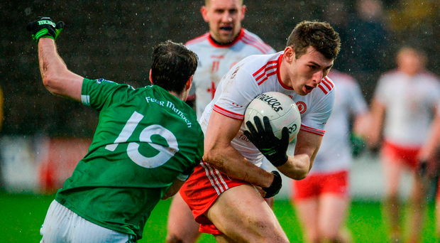 Padraig McNulty of Tyrone in action against Ruairi Corrigan of Fermanagh. Photo: Oliver McVeigh/Sportsfile