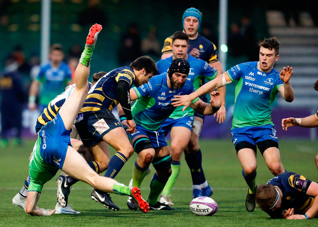 Darragh Leader (left) falls to the ground as Connacht and Worcester players prepare to battle for the ball. Photo: Malcolm Couzens/Sportsfile