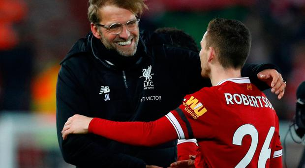 Liverpool manager Juergen Klopp and Andrew Robertson celebrate after the match