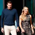 Caroline Wozniacki of Denmark and her fiancé David Lee arrive for an official players' event for the upcoming Australian Open tennis tournament. REUTERS/Edgar Su
