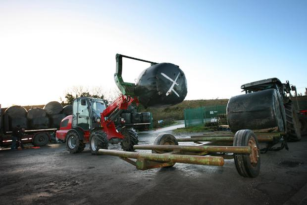 Fodder arrives in Dowra from Tipperary. Gerry McMorrow loads fodder from Tipperary onto a farmers trailer after it arrived in McMorrow Timber Yard, Dowra, Co Leitrim. Photo Brian Farrell