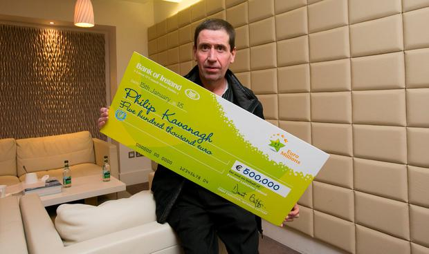 Philip Kavanagh from Bunclody, Wexford at National Lottery Offices, Dublin after he collected a cheque for €500,000 following his win on the EuroMillions Plus draw on January 9. Photo Gareth Chaney Collins