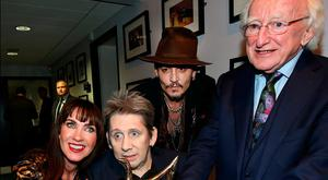 President Michael D Higgins and Johnny Depp with Shane MacGowan and Victoria Mary Clarke at his 60th birthday celebration concert at the National Concert Hall. Photo: Steve Humphreys