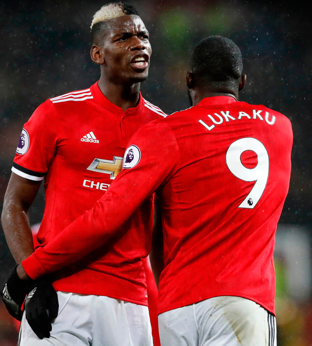 Manchester United's Romelu Lukaku (r) celebrates scoring their third goal against Stoke City with Paul Pogba during their Premier League match at Old Trafford last night