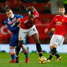 Paul Pogba holds off the challenge of Xherdan Shaqiri during Manchester United's victory over Stoke City