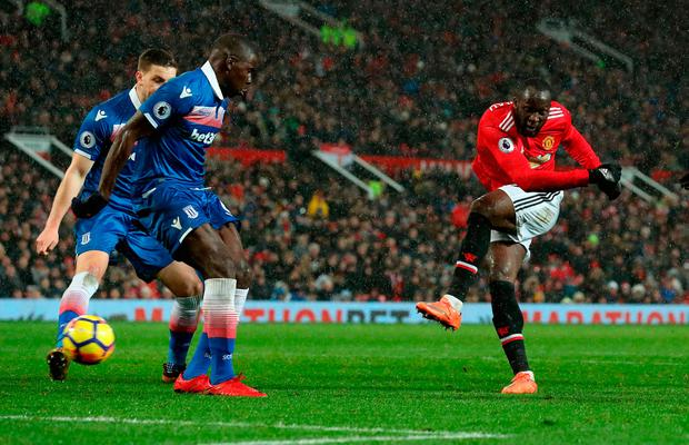 Manchester United's Romelu Lukaku scores his side's third goal of the game Photo: Martin Rickett/PA Wire