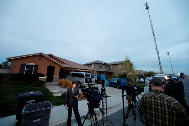 News crews gather outside the home of David Allen and Louis Anna Turpin in Perris, California, U.S., January 15, 2018. REUTERS/Mike Blake