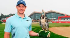 Rory McIlroy of Northern Ireland takes part in a photocall for the Abu Dhabi HSBC Golf Championship