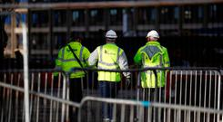 Contractors walk inside Carillion's Royal Liverpool Hospital site in Liverpool. Photo: Reuters