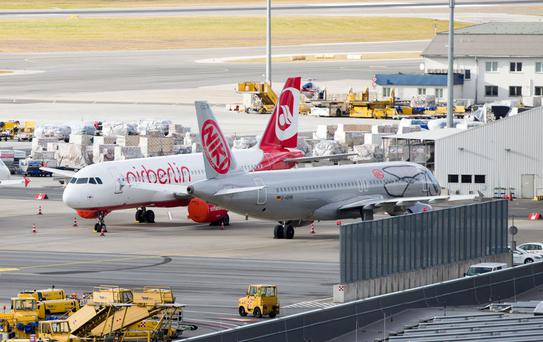 Air Berlin (L) and Niki aircrafts stand on the tarmac at the Vienna International Airport (VIC) in Schwechat, Austria. Photo: AFP/Getty Images
