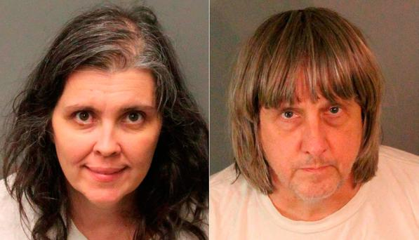 Arrested: Parents Louise Anna and David Allen Turpin. Pic: Getty Images