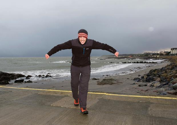 Gabriel Walsh, from Moycullen, braces against the wind in Salthill Photo: Andrew Downes