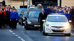 The funeral procession was escorted by fellow school pupils and friends of Sean Hughes. Photo: Gerry Mooney