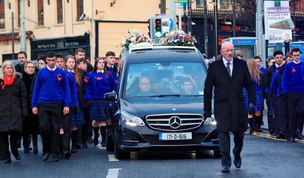 Classmates of Sean Hughes provide a guard of honour at his funeral. Photo: Collins