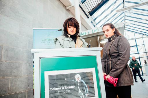 Cranberries fans, mother and daughter Deirdre and Orla O'Brien visit Limerick City and County Council HQ where a book of condolence for singer Dolores O'Riordan has been opened following her sudden death in a London hotel on Sunday. Photo: Brian Arthur