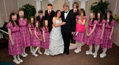 Louise and David Turpin with their 13 children, who were found chained to their beds, in a photo from their Facebook page