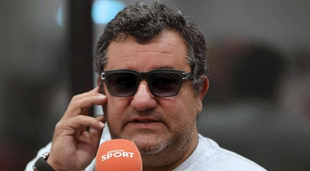 Mino Raiola: 'Sanchez is part of the Mkhi deal, not the other way round'. AFP/Getty Images