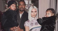 Kim and Kanye with their children Saint and and North