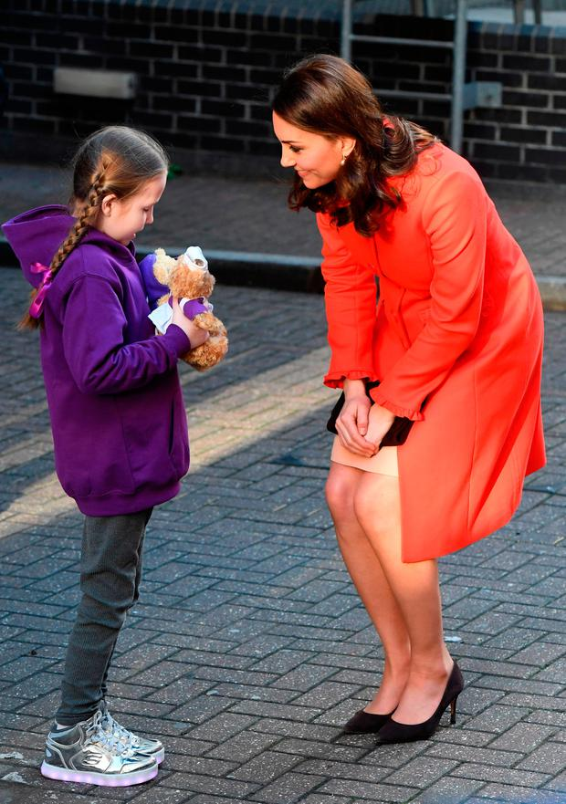 Ava Watt, aged 9 with Cystic fibrosis, presents Catherine, Duchess of Cambridge with a gift during her visit to Great Ormond Street Hospital on January 17, 2018 in London, England. (Photo by Stuart C. Wilson/Getty Images)