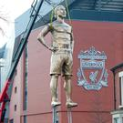 A 30ft-high statue of Virgil van Dijk was unveiled outside Anfield as part of a PR stunt by The Public House