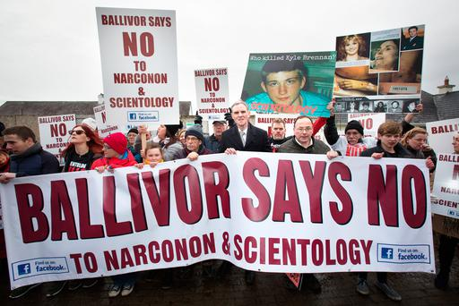 Local TD Shane Cassells (centre) with Ballivor residents at a protest against Scientology outside the old national school in the village. Photo: Tony Gavin
