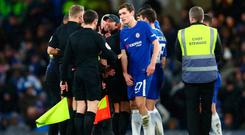 Chelsea manager Antonio Conte confronts referee Graham Scott at the end of extra-time. Photo: Getty