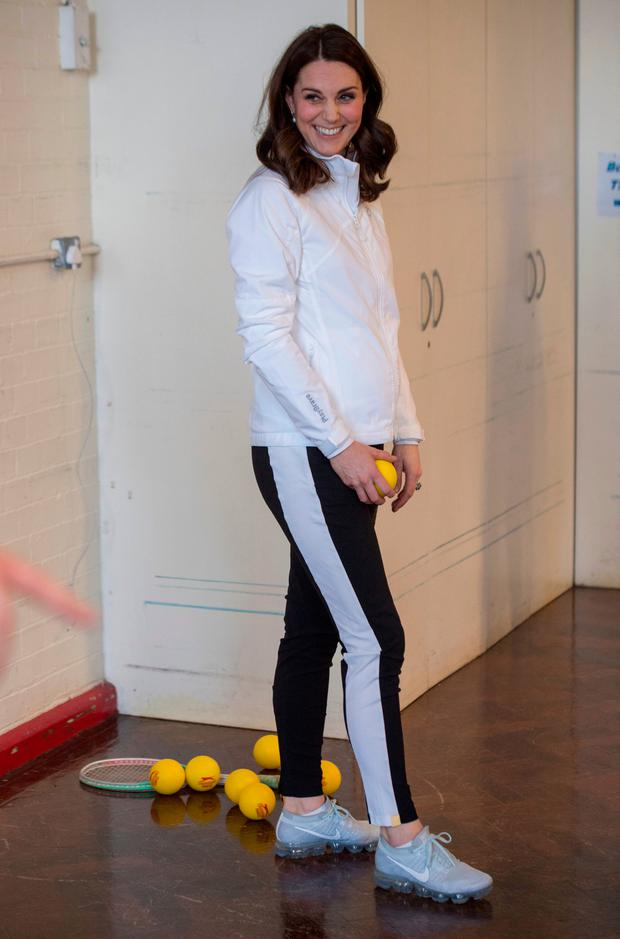 Catherine, Duchess of Cambridge, Patron of the All England Lawn Tennis and Croquet Club (AELTC) plays a game during a visit to Bond Primary School in Mitcham to see the work of the Wimbledon Junior Tennis Initiative (WJTI) on January 17, 2018 London, United Kingdom. (Photo by Arthur Edwards - WPA Pool/Getty Images)