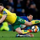 Chelsea's Pedro fouls Norwich City's Wesley Hoolahan resulting in him receiving his second yellow card and being sent off