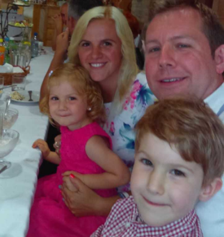 Filip Fraszczyk (5) with his mother Magdalena, father Piotr, and his sister Olivia.