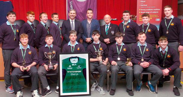 Members of St Muredach's College victorious Connacht League and Cup Junior and Senior rugby teams pictured at the college prize-giving ceremony with Connacht Rugby CEO Willie Ruane, former IRFU Connacht branch president Gerry O'Donnell and team coach Emmet Peyton
