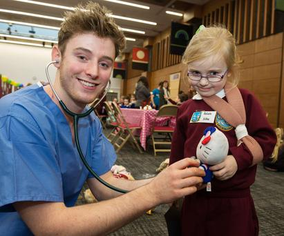 Medical student David O'Sullivan talks to Róisín Silke, from Corrrandulla National School, at the Teddy Bear Hospital at NUI Galway. Photo: Andrew Downes