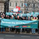 Protesters outside Leinster House yesterday. Photos: Damien Eagers