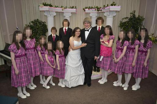 David and Louise Turpin with their 13 children as they renew their wedding vows in the Elvis Chapel, Las Vegas, in 2015
