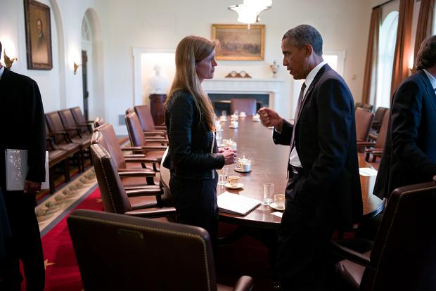 President Barack Obama talks with Amb. Samantha Power, U.S. Permanent Representative to the United Nations, following a Cabinet meeting in the Cabinet Room of the White House, Sept. 12, 2013. (Official White House Photo by Pete Souza) This official White House photograph is being made available only for publication by news organizations and/or for personal use printing by the subject(s) of the photograph. The photograph may not be manipulated in any way and may not be used in commercial or political materials, advertisements, emails, products, promotions that in any way suggests approval or endorsement of the President, the First Family, or the White House.