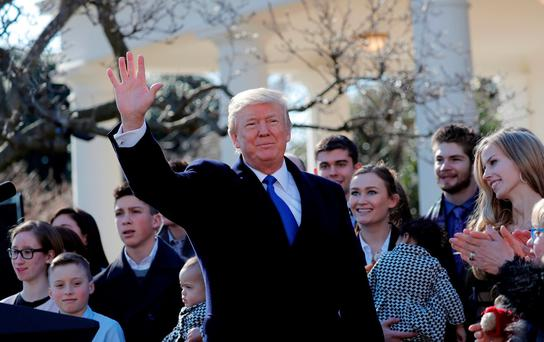U.S. President Donald Trump waves after addressing the annual March for Life rally, taking place on the National Mall, from the White House Rose Garden in Washington, U.S., January 19, 2018. REUTERS/Carlos Barria