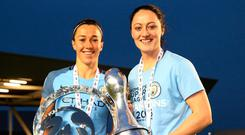 Irish international Megan Campbell (right) alongside Manchester City team-mate Lucia Bronze and the Women's Super League 1 trophy. Photo: Alex Livesey/Getty Images