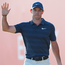 Rory McIlroy acknowledges the cheers after his eagle on the 18th in Abu Dhabi. Photo: Getty Images
