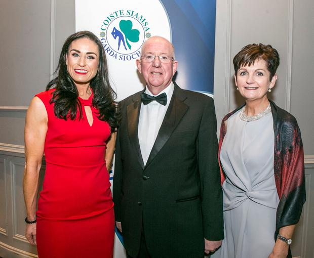 Garda Eve McCrystal with Minister for Justice Charlie Flanagan TD and Asst Commissioner Anne Marie McMahon pictured at the 24th Annual Coiste Siamsa Garda Sportstar Awards in The Midlands Park Hotel in Portlaoise Pic credit: Kyran O'Brien