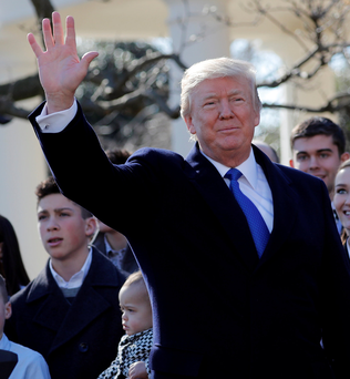 US President Donald Trump waves after addressing the annual March for Life rally from the White House Rose Garden in Washington. Photo: Reuters