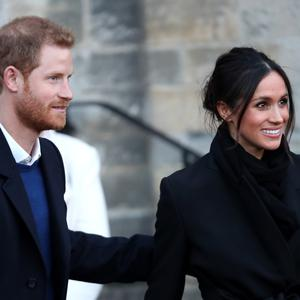 Prince Harry and his fiancee Meghan Markle depart from a walkabout at Cardiff Castle on January 18, 2018 in Cardiff, Wales. (Photo by Chris Jackson/Chris Jackson/Getty Images)