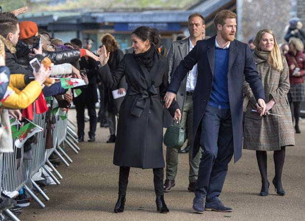 Britain's Prince Harry and fiancée US actress Meghan Markle greets well-wishers on arrival at Cardiff Castle in Cardiff, south Wales on January 18, 2018, for a day showcasing the rich culture and heritage of Wales. / AFP PHOTO / POOL / Arthur Edwards (Photo credit should read ARTHUR EDWARDS/AFP/Getty Images)