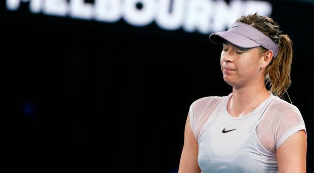 Kerber crushes Sharapova in showdown at Open