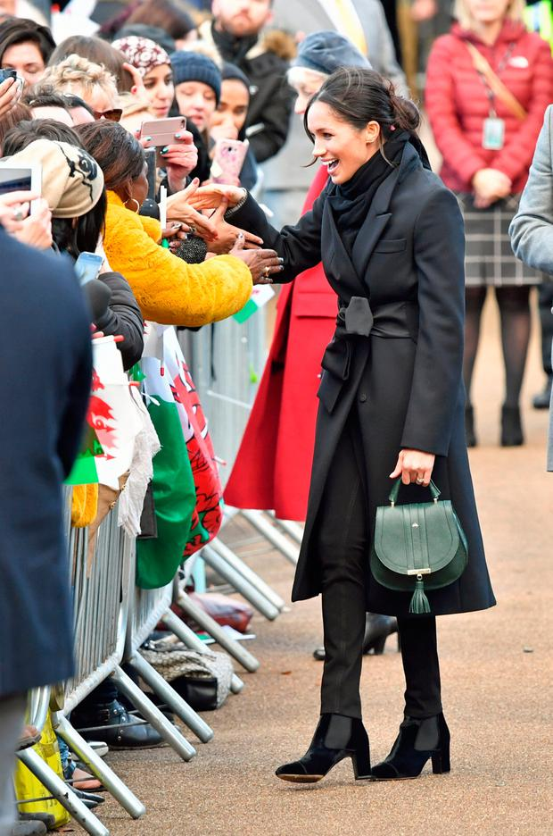 Crowds greet Britain's Prince Harry's fiancee Meghan Markle during a visit to Cardiff Castle in Cardiff, Britain, January 18, 2018. REUTERS/Ben Birchall/Pool