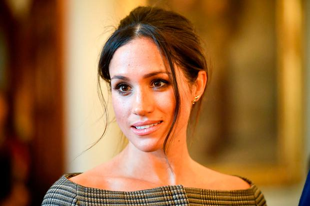 Meghan Markle chats with people inside the Drawing Room during a visit to Cardiff Castle in Cardiff, Britain, January 18, 2018. REUTERS/Ben Birchall/Pool