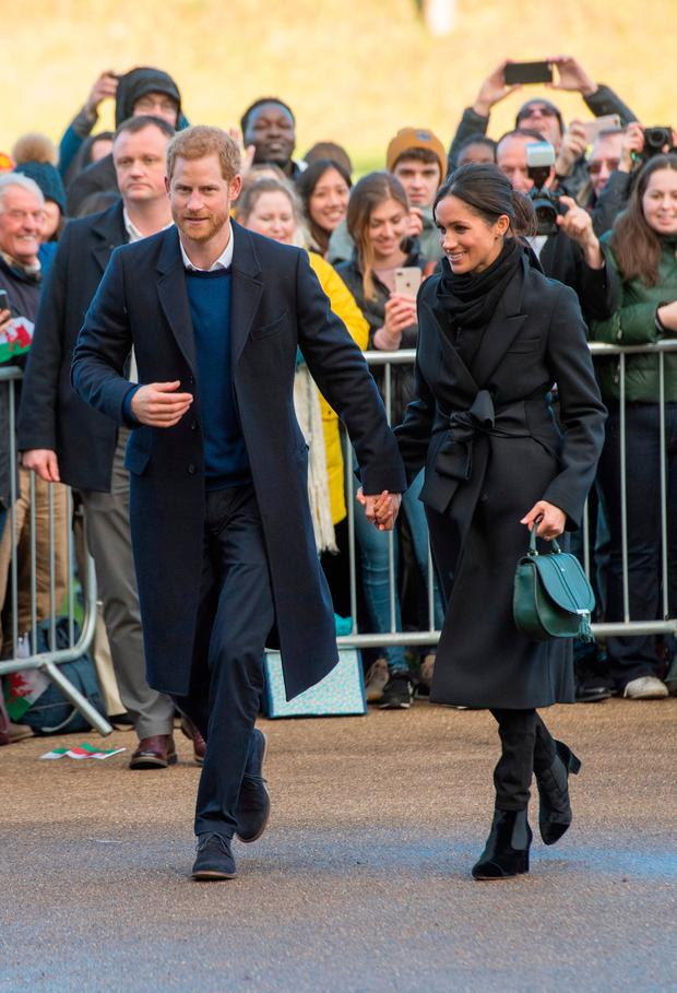 Prince Harry and Meghan Markle meet members of the public during a walkabout as they visit Cardiff Castle