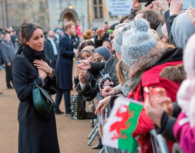 Meghan Markle meets members of the public during a walkabout as she visits Cardiff Castle